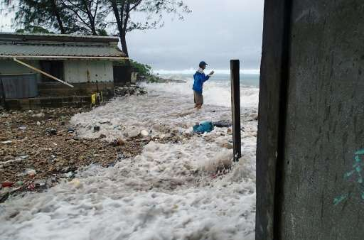 A high tide energised by storm surges washes into a community on Ejit, an island in the Pacific's Marshall Islands chain