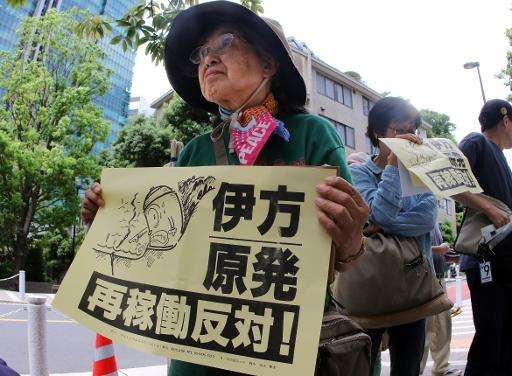A Japanese anti-nuclear protester demonstrates outside the Nuclear Regulation Authority (NRA) in Tokyo, on May 20, 2015
