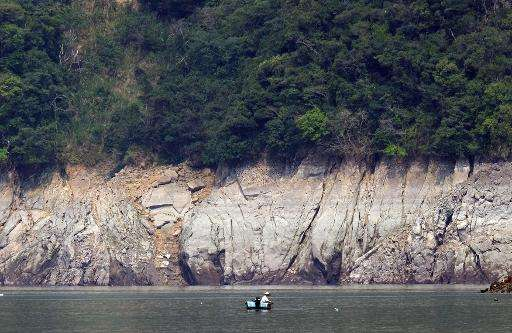 A local resident is seen fishing at Shihman dam in northern Taoyuan, on March 20, 2015