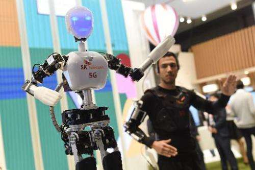 A man operates an SK telecom robot during the 2015 Mobile World Congress in Barcelona on March 3, 2015