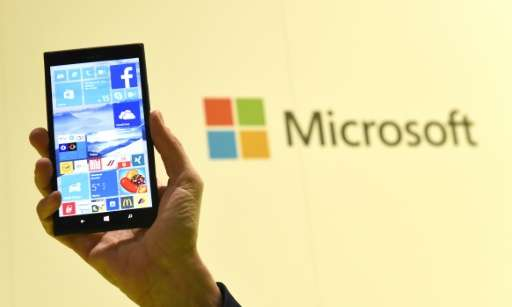A man shows Microsoft's Windows 10 operating system at the CeBIT technology fair in Hanover on March 15, 2015