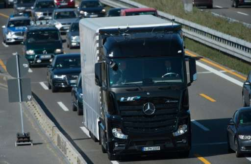 A Mercedes-Benz Actros truck equipped with a self-driving system takes to the highway