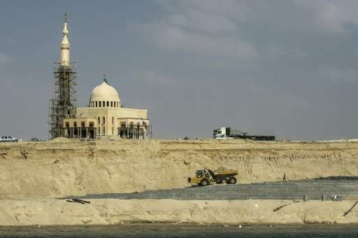A mosque under construction on the banks of the new waterway of the Suez canal, which will be inagurated on August 6, 2015
