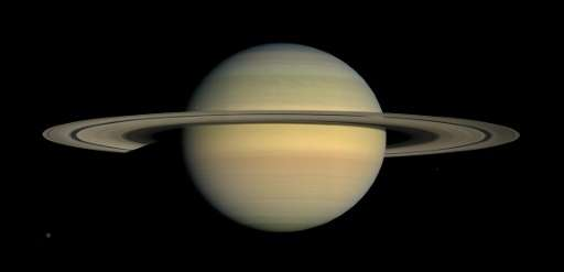 A NASA photo shows Saturn and its main rings seen by Cassini spacecraft, with the 'F ring' located just oustide the main rings