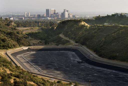 An empty water reservoir is seen in the hills above Los Angeles as a severe drought continues to affect the state of California