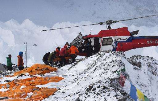 An injured person is loaded onto a rescue helicopter at Everest Base Camp on April 26, 2015, a day after an avalanche triggered