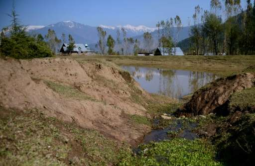 A partially dried up pond that irrigates paddy fields pictured in Chandigam village in the Lolab Valley in the foothills of the