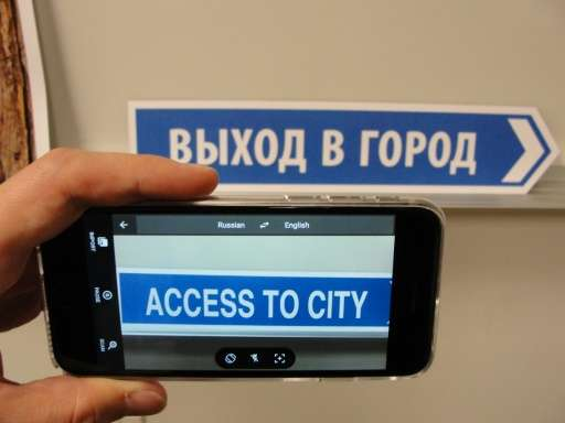 A person uses the Google Translate application on January 12, 2015 in San Francisco