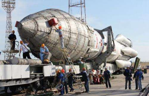 A Proton-M rocket is transported to the launch pad at Russian leased Kazakhstan's Baikonur cosmodrome, on May 14, 2012