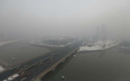 A residential block covered in smog in Changchun, northeast China's Jilin province
