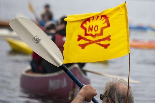A ShellNo flotilla participant paddles in a kayak during demonstrations on May 16, 2015 in Seattle, Washington