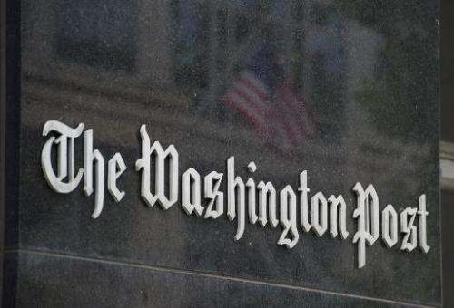 A sign hangs on the outside of the Washington Post building on August 6, 2013 in Washington, DC