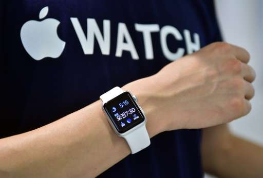 A South Korean employee shows the Apple Watch at an Apple shop in Seoul on June 26, 2015
