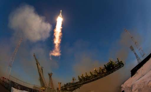A Soyuz TMA-19M rocket carrying Tim Kopra of NASA and Tim Peake of the European Space Agency launches on  December 15, 2015 at t