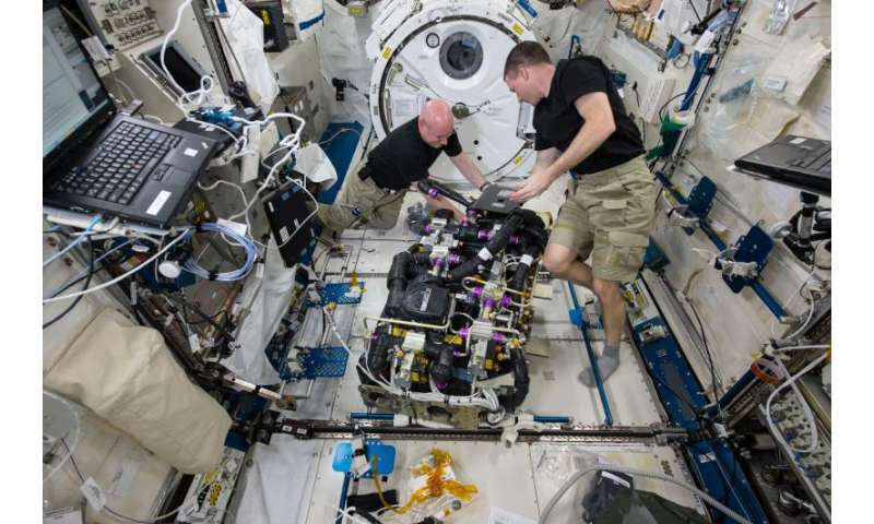 Astronauts at work on the International Space Station