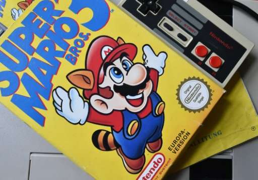 A 'Super Mario 3' game is seen on top of a 1980's NESgames console, in Berlin