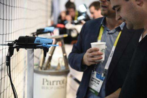 Attendees look at the Parrot BeBop Drone Quadcopter with Skycontroller, January 6, 2015 at the Consumer Electronics Show in Las