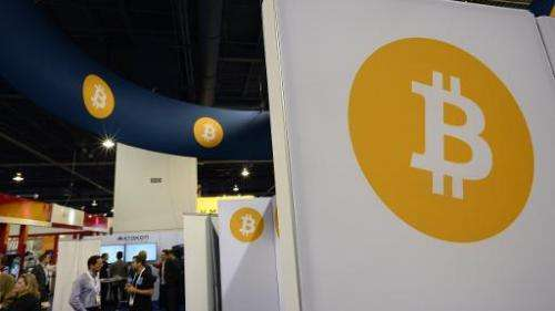 Attendees visit the Bitcoin stand, January 6, 2015 at the Consumer Electronics Show in Las Vegas, Nevada
