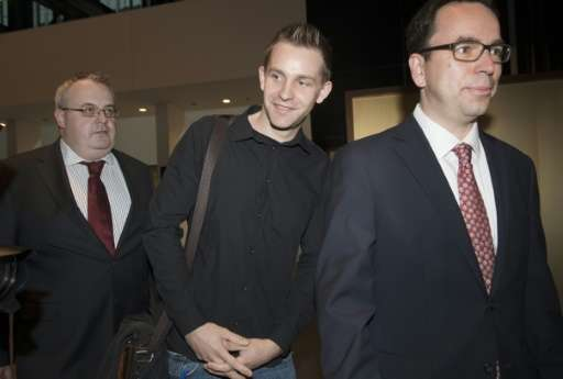 Austrian Max Schrems (C) arrives with his lawyer Herwig Hofmann (R) before a verdict at the European Court of Justice (SCJ) in L