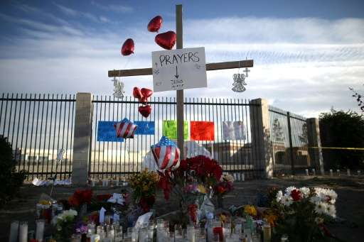A view of a makeshift memorial near the Inland Regional Center on December 4, 2015 in San Bernardino, California
