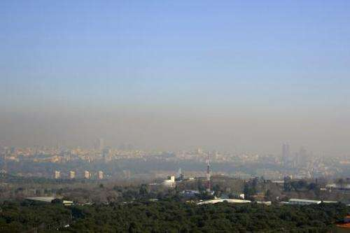 A view taken on February 9, 2011 from Casa de Campo park, in the west of Madrid, shows the pollution covering the sky of the Spa