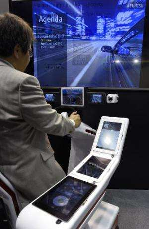 A visitor tests the In-Vehicle Service of Fujitsu during the 2015 Mobile World Congress in Barcelona on March 4, 2015