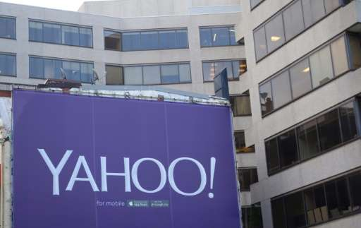A Washington, DC building is wrapped in a billboard for the troubled technology company Yahoo, said December 8 2015 to be a poss
