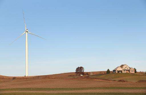 A wind turbine rises up above farmland near Middleton, Wisconsin on November 19, 2013