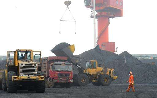 A worker walks at a coal terminal at Lianyungang port in Lianyungang, China, on June 23, 2014