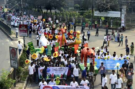 Bangladesh people attend a Climate March rally expressing solidarity with Global Climate March, in Dhaka on November 28, 2015