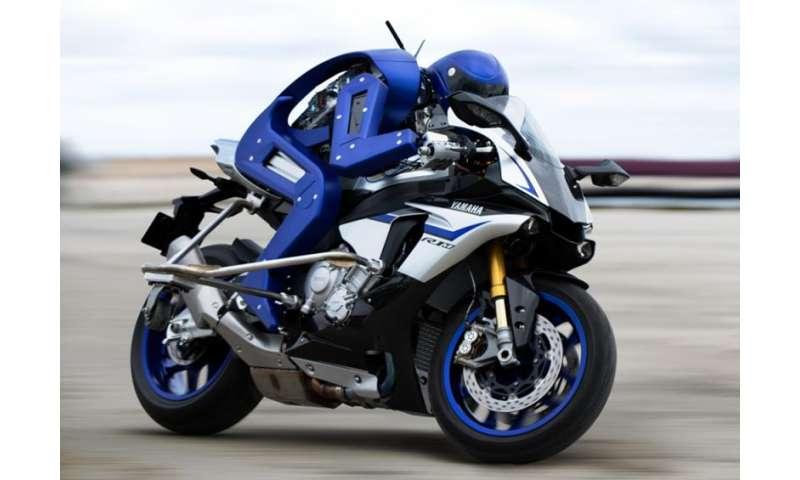 Bike-riding robot turns heads at Tokyo motor event