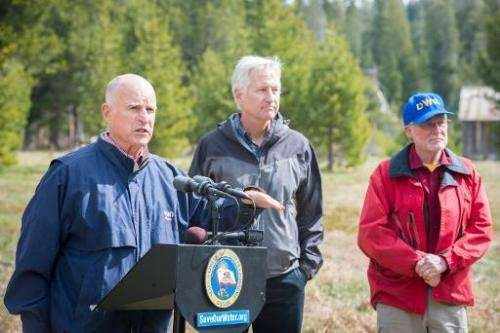 California Governor Jerry Brown (L) addresses a press conference with California Department of Water Resources workers in Philli
