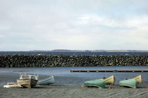 Canoes and boats lying at the waters edge in the Inuit village of Umiujaq, in Nunavik territory, Hudson Bay, Quebec