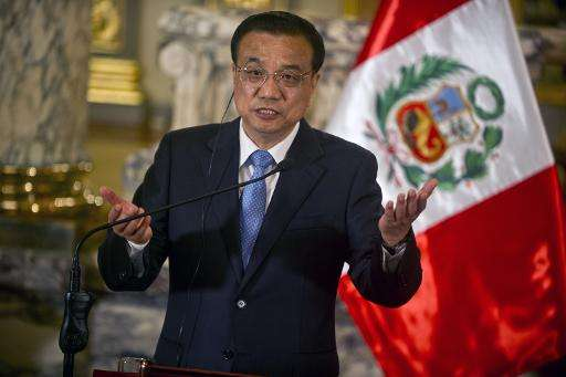 China's Prime Minister Li Keqiang delivers a speech during a ceremony with Peruvian President Ollanta Humala (out of frame) at t