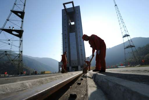 Chinese workers make final preparations to the launch pad at the Xichang Satellite Launch Centre in the southwestern province of