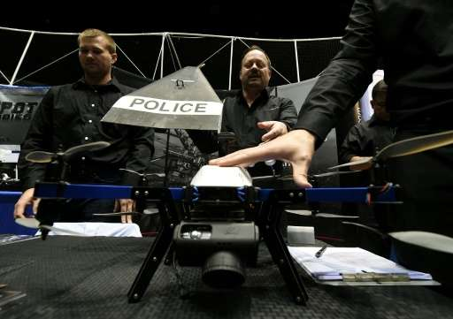 Consultants from Flyspan Solutions demonstrate a drone intended for police use, during the first-ever Drone Expo in Los Angeles,
