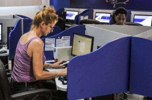 Cubans visit a cybercafe in Havana on June 21, 2013