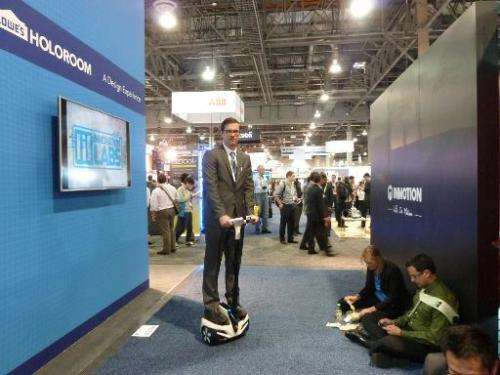 David Fisher of Inmotion SCV demonstrates the company's personal transporter at the Consumer Electronics Show on January 8, 2015