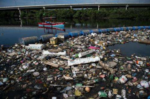 Debris caught by connected floating buoys at the Penha Canal that streams directly into the Guanabara bay in Rio de Janeiro, Bra