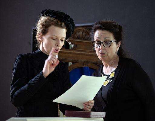 Director Marie Noelle (R) and actress Karolina Gruszka, who plays Maria Sklodowska-Curie, during the making of a biopic about th