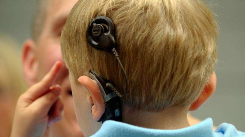 Double cochlear implants improve student grades