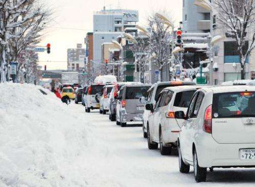 Energy saving traffic lights in Japan are failing to melt snow covering them