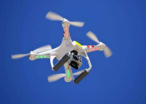 Experts are looking at the potential risk drones pose to aircraft