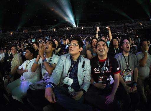 Fans react to announcements of new games ahead of the opening of the Electronic Entertainment Expo, known as E3 on June 15, 2015