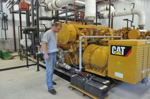 Farmer Ryan Rogers checks on a generator at Homestead Dairy in Plymouth, Indiana, which invested in a biogas recovery system whi