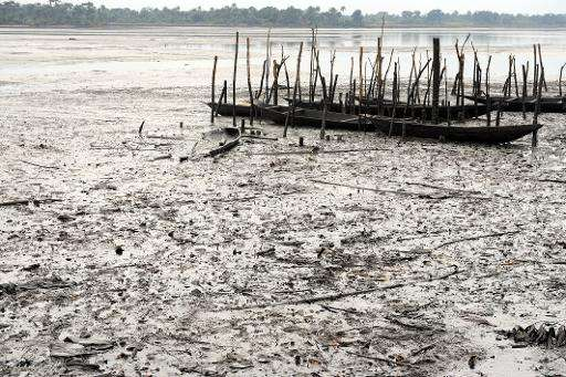Fishing boats are abandoned on Bodo waterways polluted by spilled crude oil allegedly caused by Shell equipment failure in Ogoni