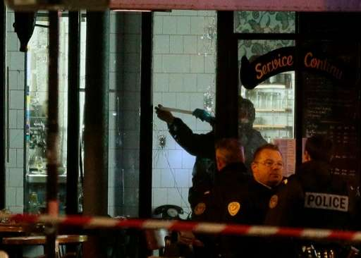Forensic police search for evidence inside the La Belle Equipe cafe, rue de Charonne, at the site of an attack on November 14, 2