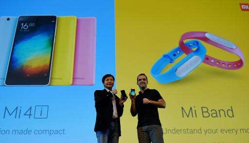 Founder, Chairman and CEO of  Xiaomi Global, Lei Jin (L) and Vice President, Hugo Barra gesture during the launch of Xiaomi's Mi