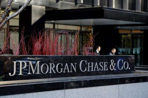 Four people have been charged n a hacking scheme targeting banking giant JPMorgan Chase, whose New York headquarters is pictured
