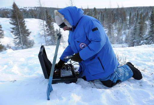 French biologist and leading scientist at Takuvik Joint International Laboratory sets up equipment to detect temperature changes